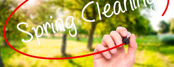 Man Hand writing Spring Cleaning with black marker on visual screen. Isolated on background. Business technology internet concept. Stock Photo